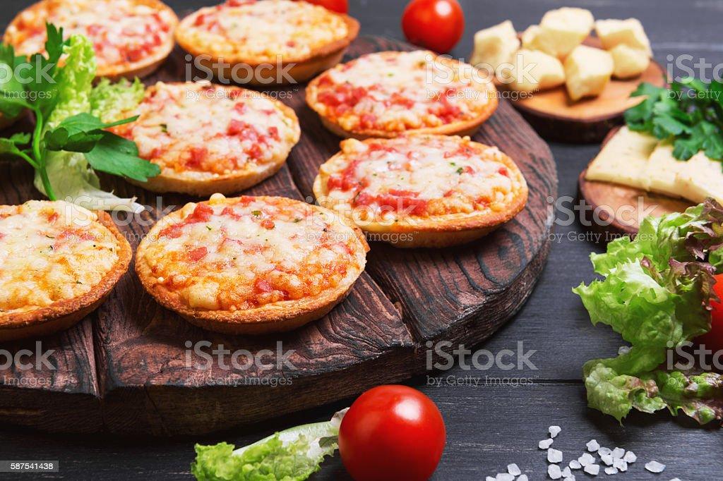 Small pizza with mozzarella cheese stock photo