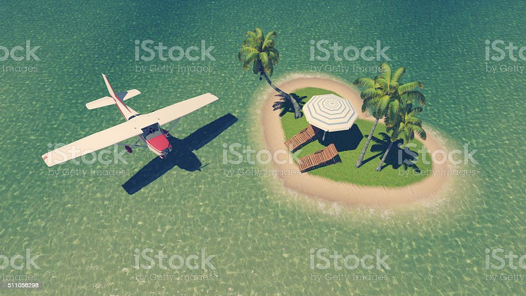 Small plane above heart shaped tropical islet stock photo