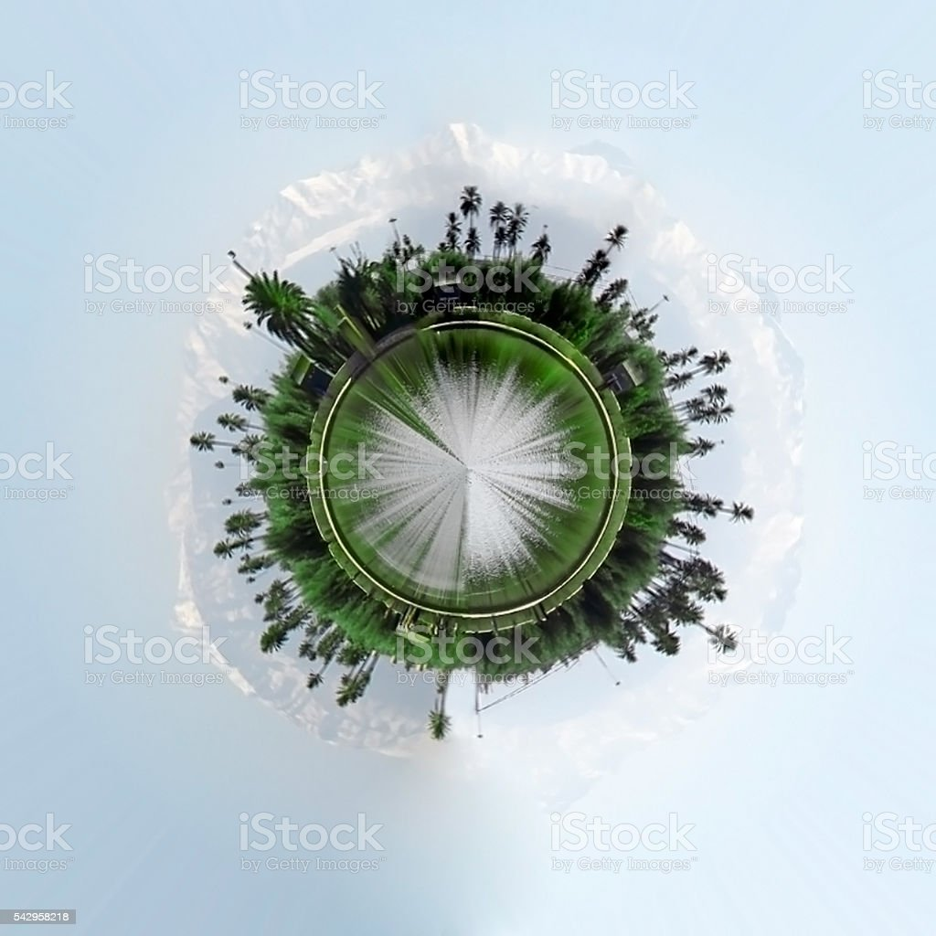 Small planet island city with palm trees stock photo