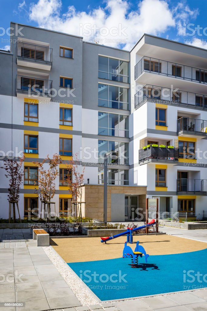 Small playground in front of the new apartment building stock photo