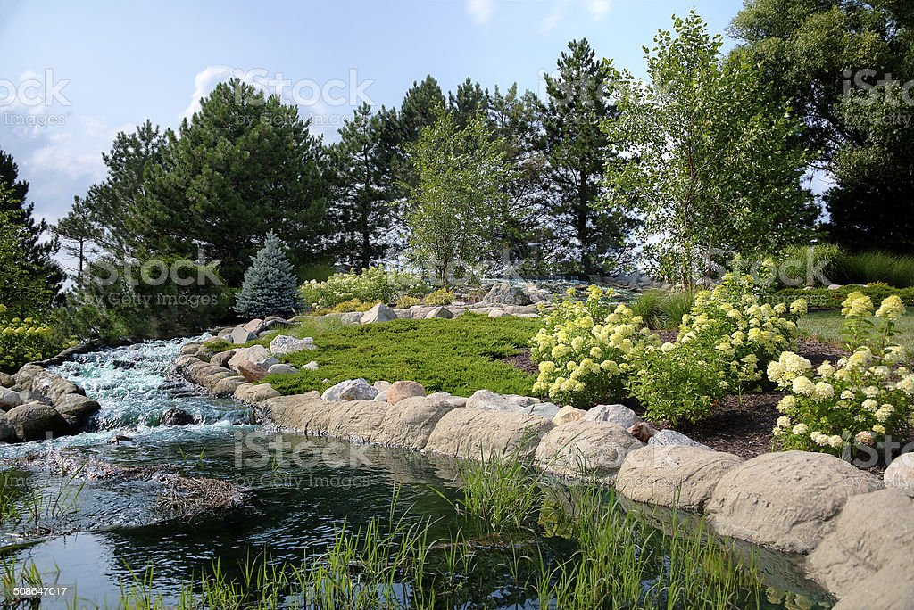 Small pond and waterfall stock photo