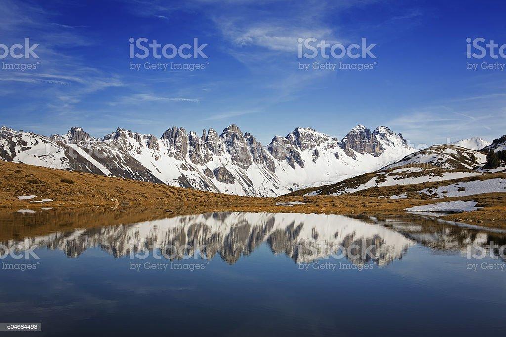 Small pond in european alps stock photo