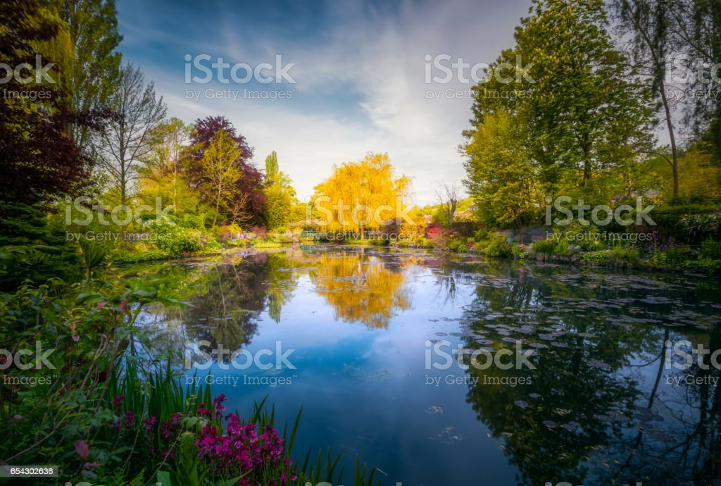 Small pond with lilies and flowers, Vernon, France stock photo