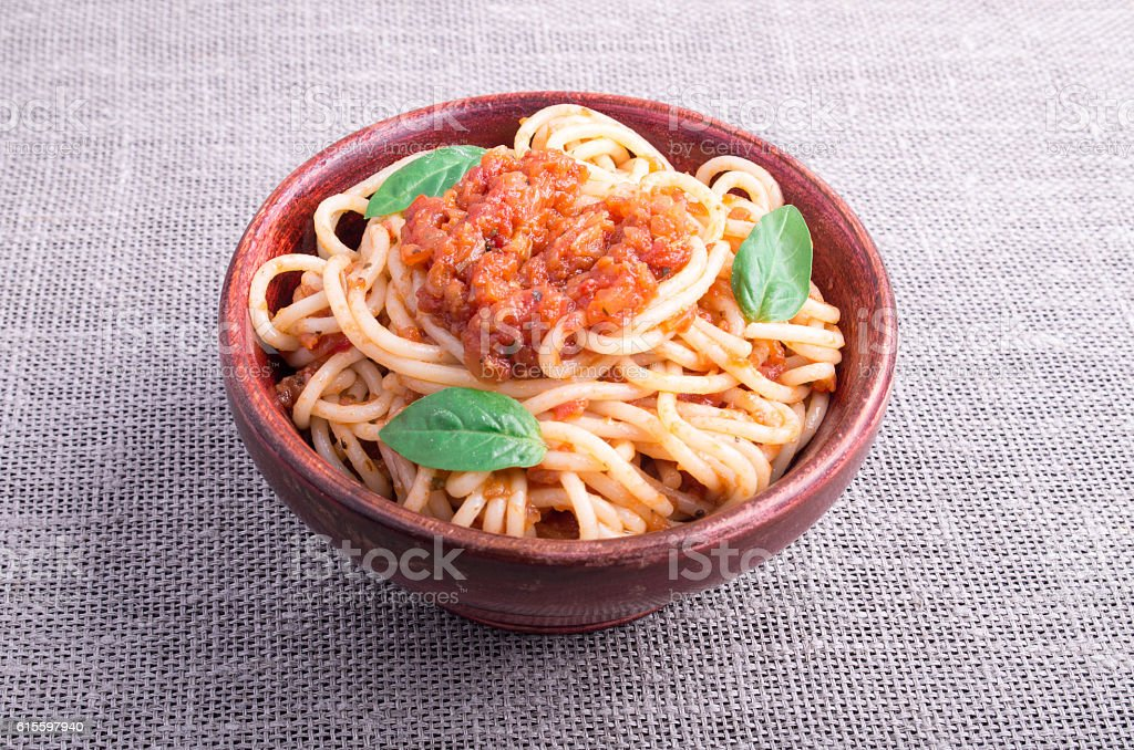 Small portion of cooked spaghetti with tomato relish closeup stock photo