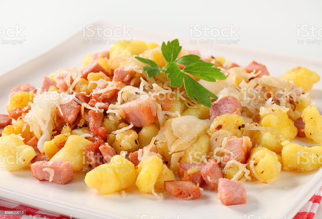 Small potato dumplings (halushky) with bacon stock photo