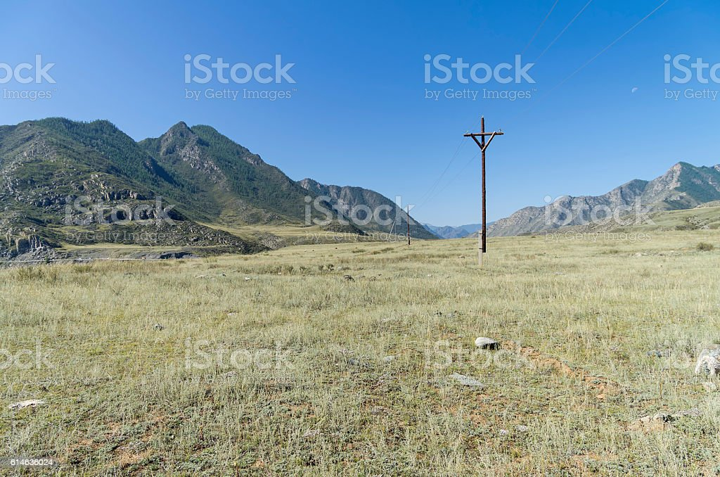Small power line in the Altai mountains. Russia. stock photo