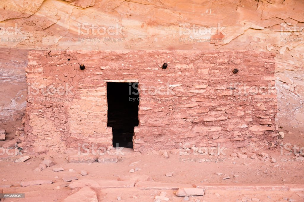 Small Puebloan dwelling in an alcove in desert sansdtone wall stock photo