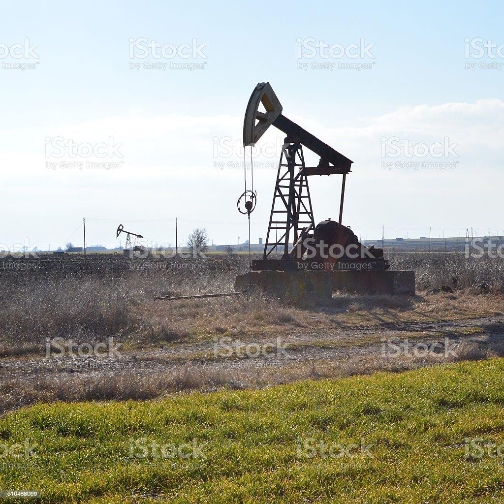 Small Pump Jack in the fields near Sabla, Bulgaria stock photo
