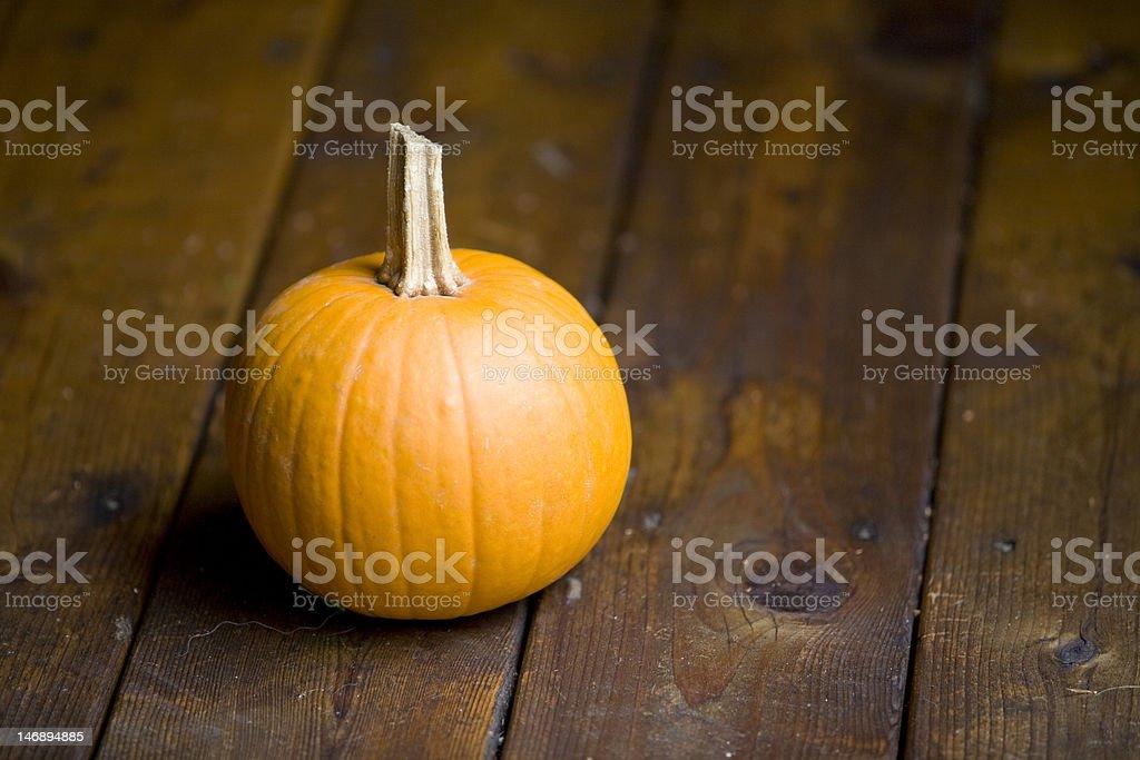 small pumpkin on wooden porch,horizontal format stock photo
