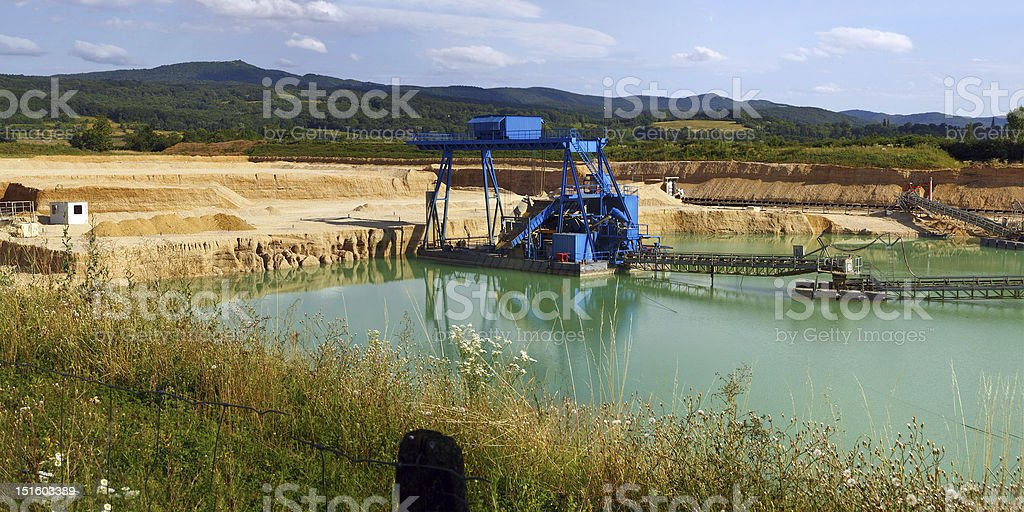 Small quarry operation with water stock photo