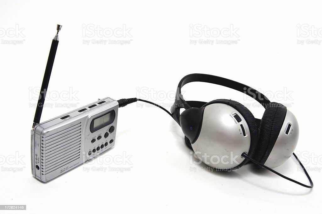 small radio, big headphones stock photo