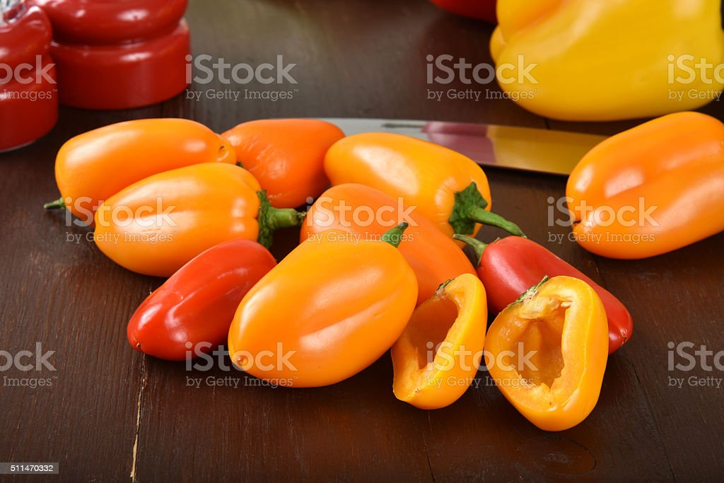 Small red and yellow peppers stock photo