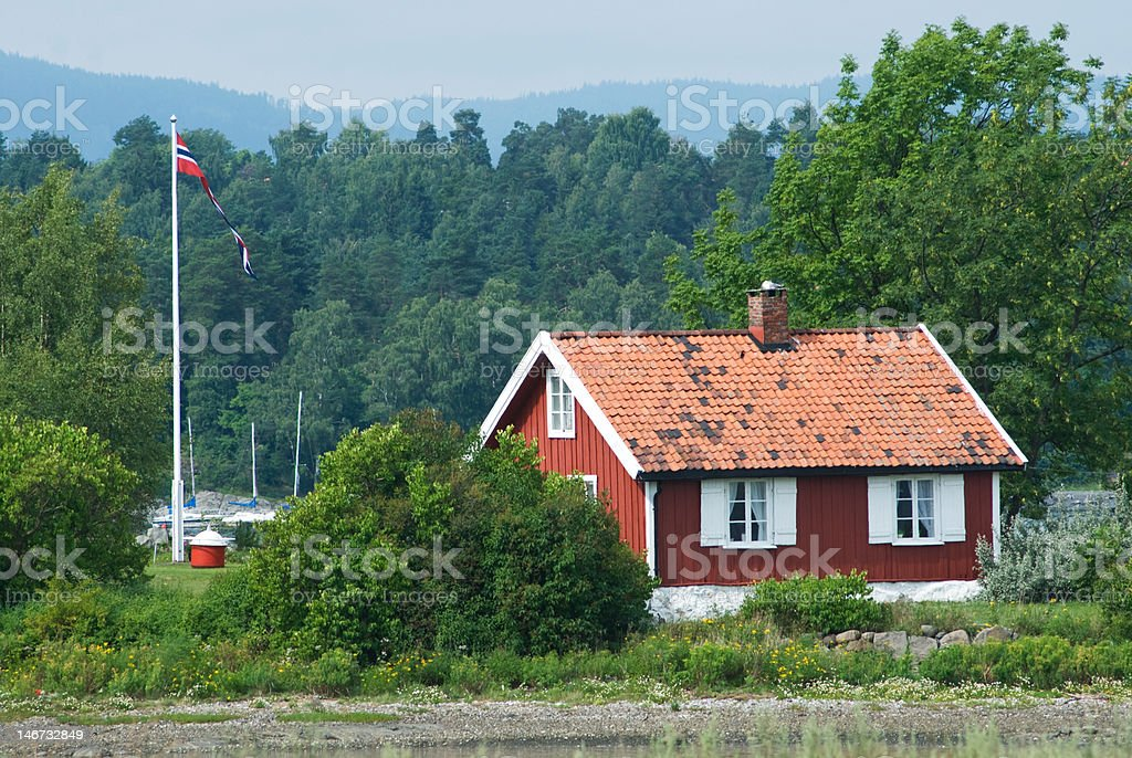 Small, red house in Norway royalty-free stock photo