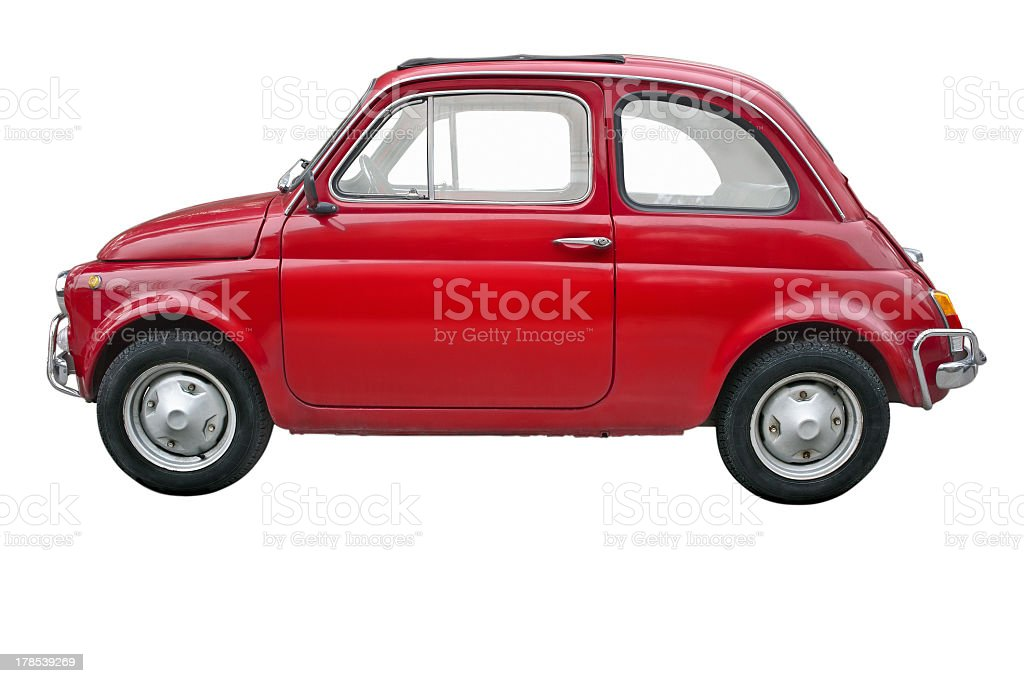 A small red old fashioned Fiat car on a white background stock photo