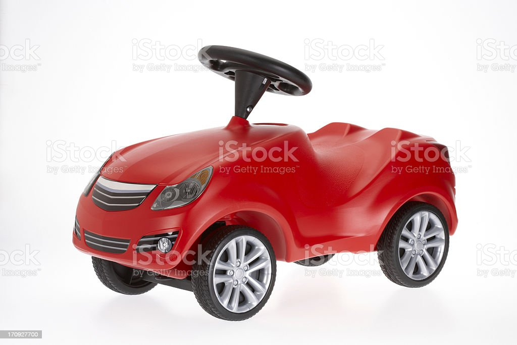 Small red toy car side view on white background stock photo
