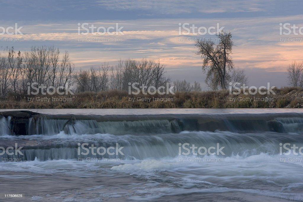 small river diversion dam in north eastern Colorado stock photo