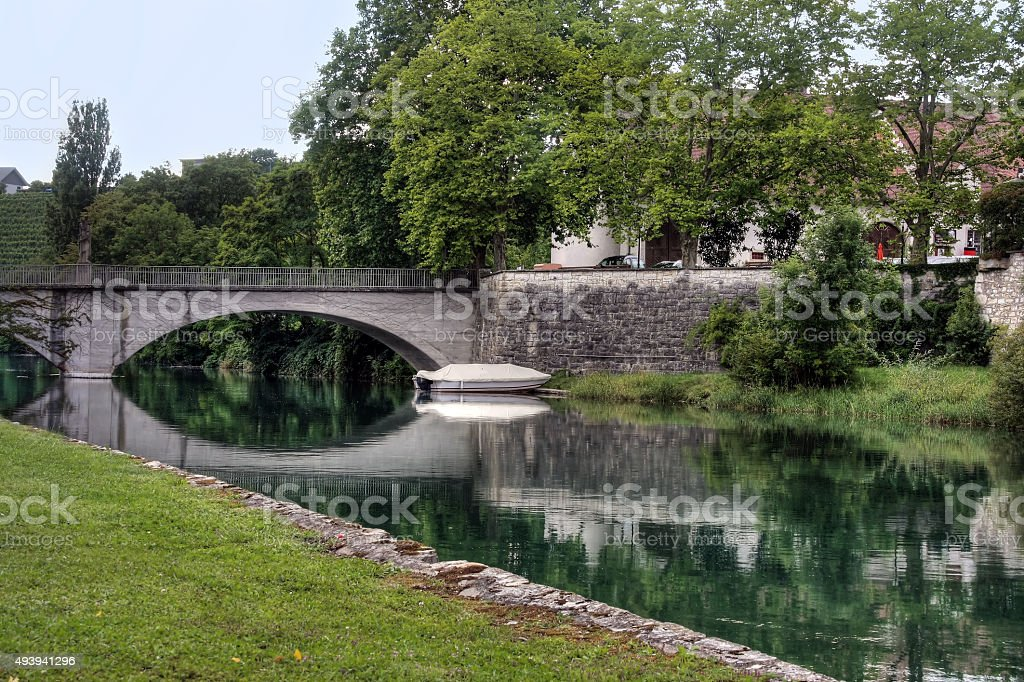 Small river with a stone bridge stock photo