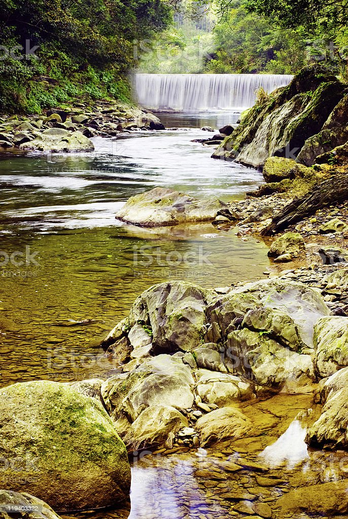 Small river with waterfall and rocks. royalty-free stock photo