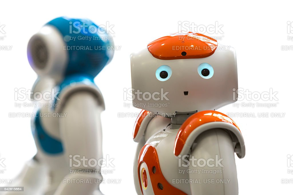 Small robots with human face and body. AI stock photo