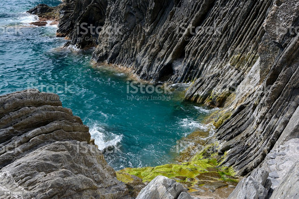 Small rocky bay nearby Vernazza, Italy stock photo
