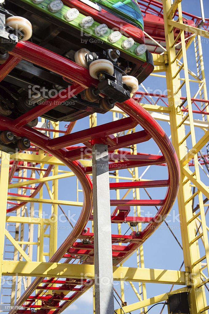 Small Rollercoaster on blue sky royalty-free stock photo