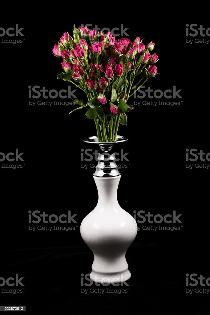Small roses and white vase stock photo