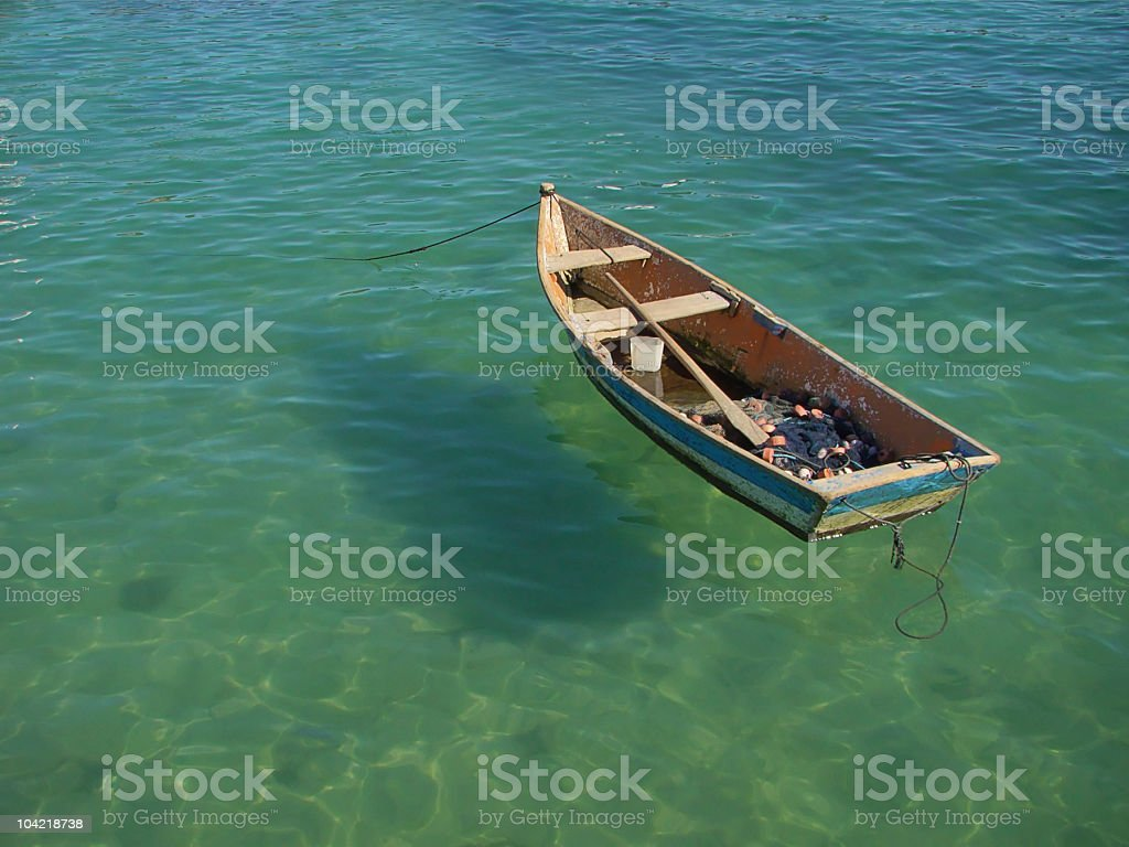 small row boat floating on the water stock photo
