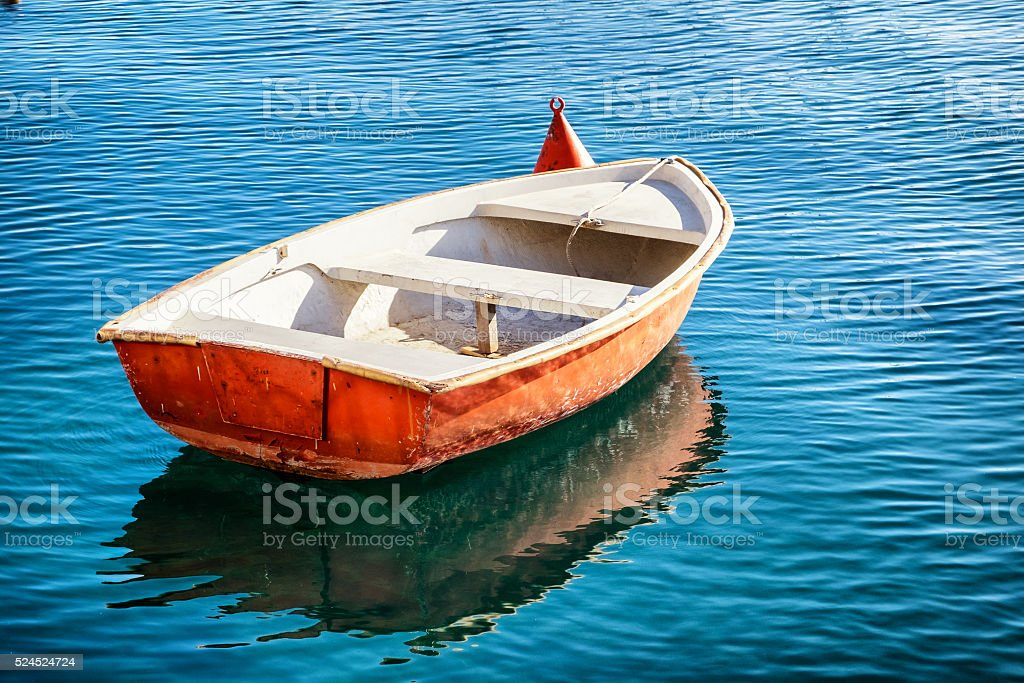 small row boat stock photo