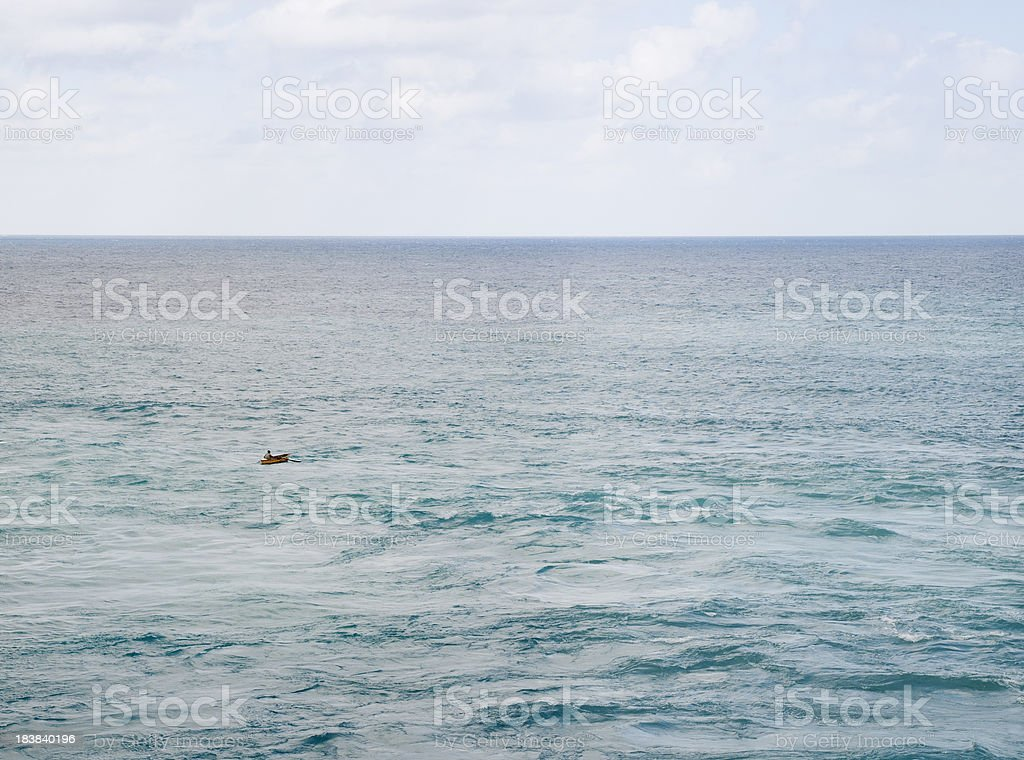 Small Rowboat on the Big Ocean royalty-free stock photo
