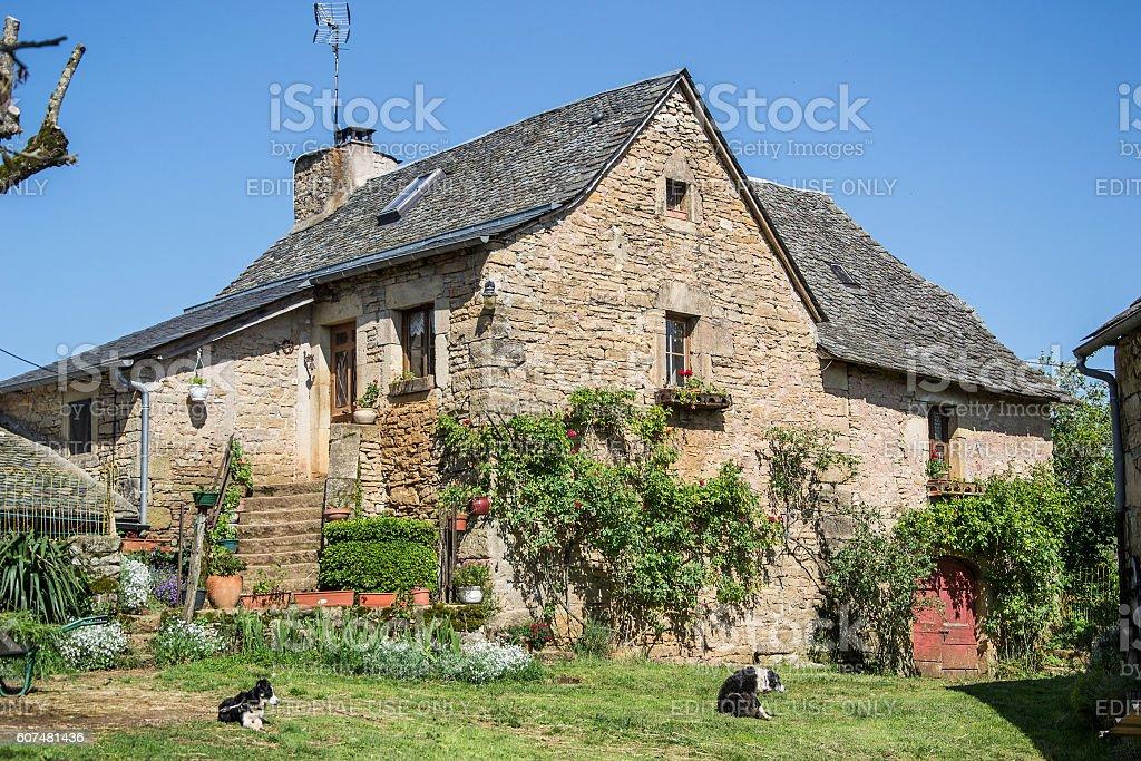 small rural farmhouse with garden stock photo