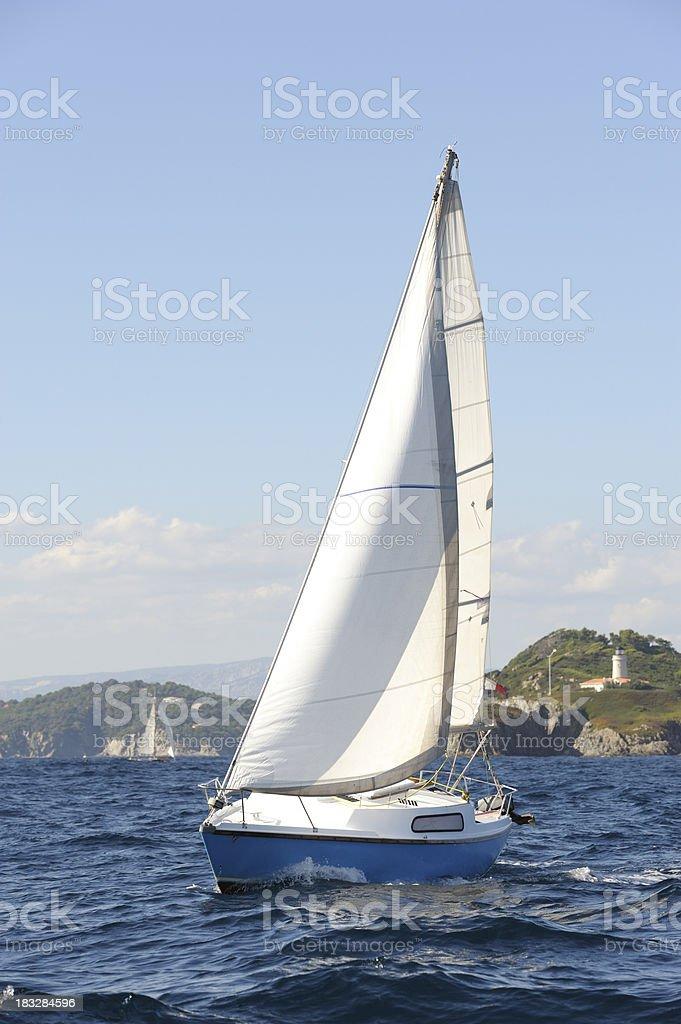 Small Sailing Yacht Cruising the Mediterranean Sea royalty-free stock photo
