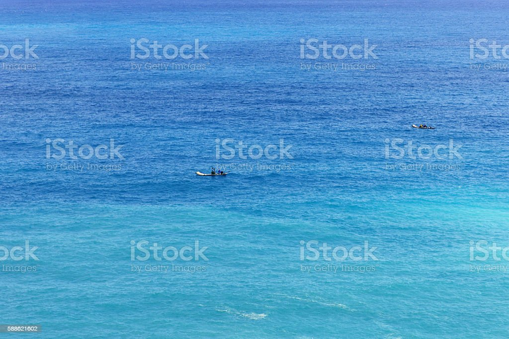 Small sampan boat in the vast expanse sea stock photo