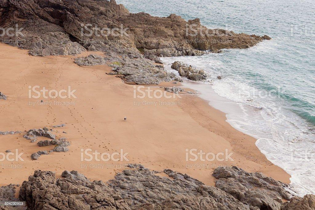 Small sand beach between cliffs in Brittany stock photo