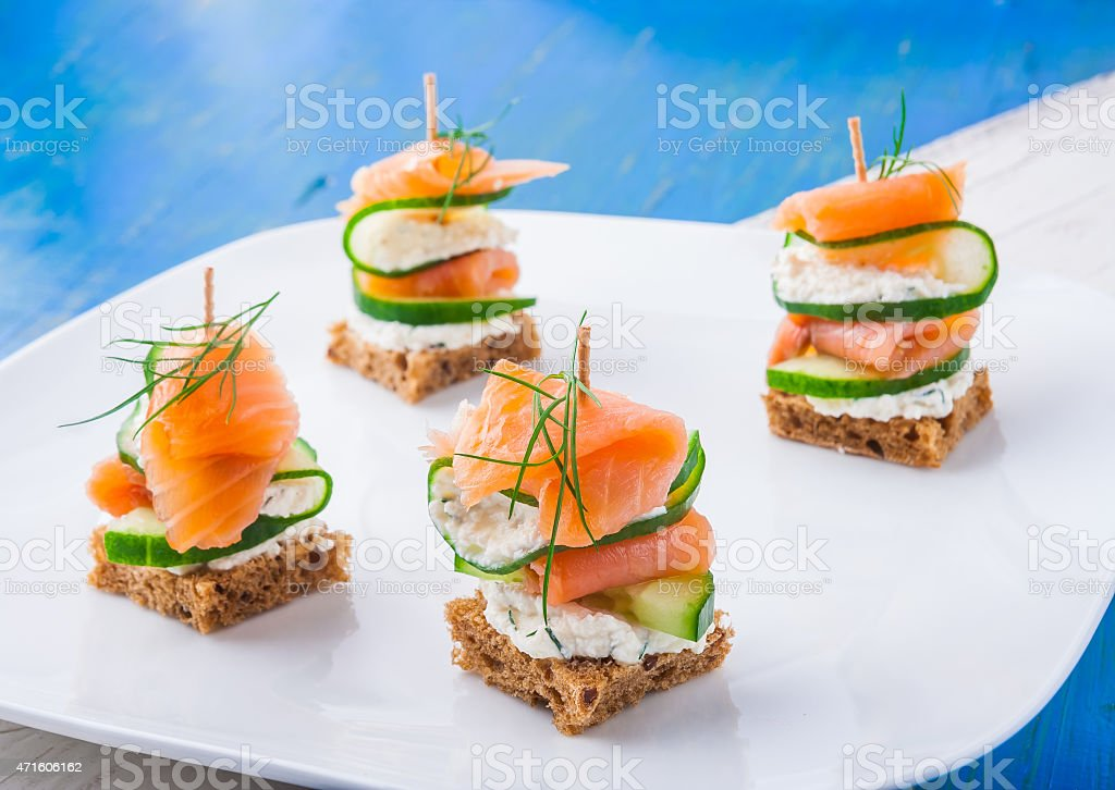 small sandwiches with salmon and cream cheese stock photo