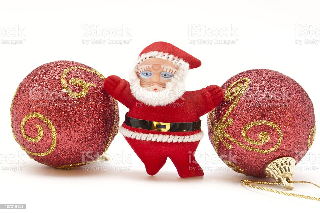 Small Santa Claus standing between Christmas toys royalty-free stock photo