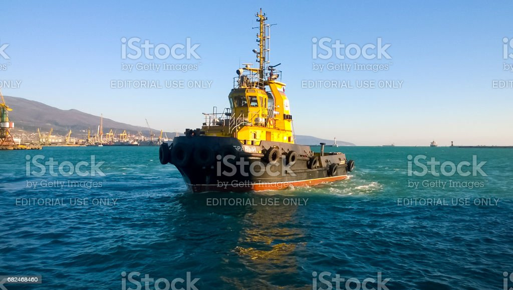 A small service ship in a cargo industrial port. A ship in the s stock photo