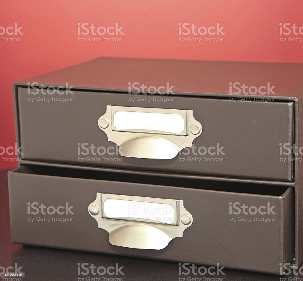 Leather set of drawers with blank nameplate.