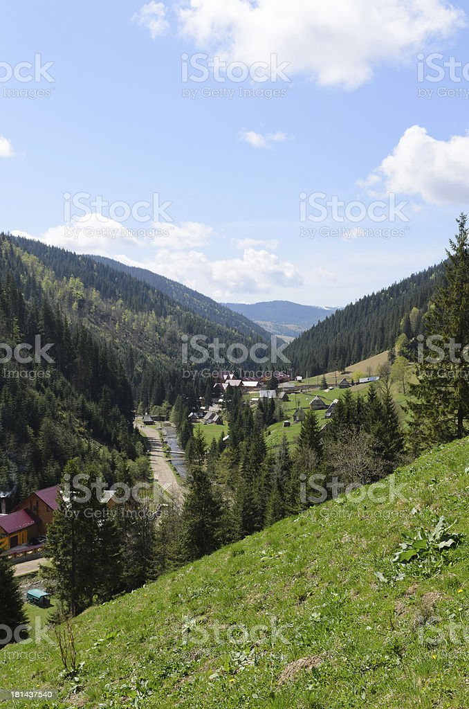 Small settlement in a mountain valley royalty-free stock photo