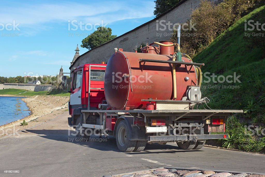 Small sewage truck stock photo