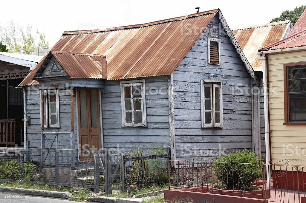 Small shack with rusty roof stock photo