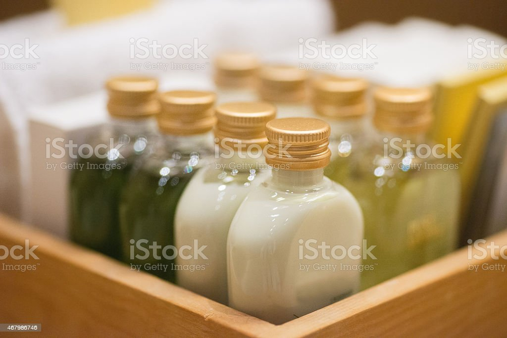 small shampoo bottles in wodden basket in hotel room stock photo