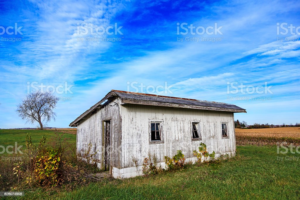 Small shed surrounded by farmland stock photo