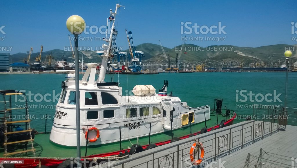 A small ship moored to the pier in the port stock photo