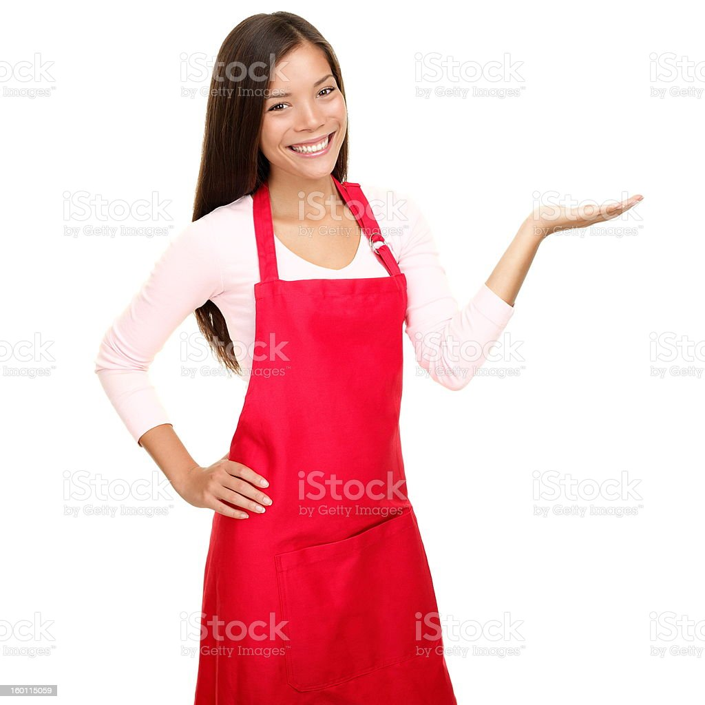 small shop owner showing in apron stock photo