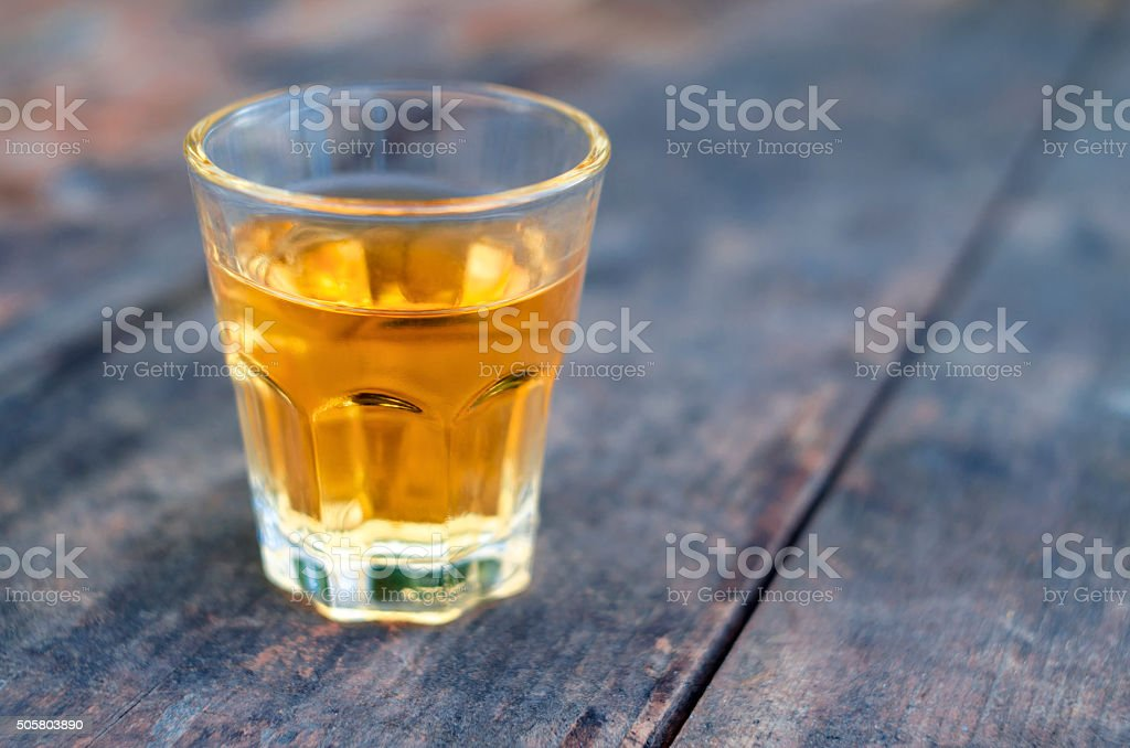 Small shot glass of alcoholic beverage stock photo