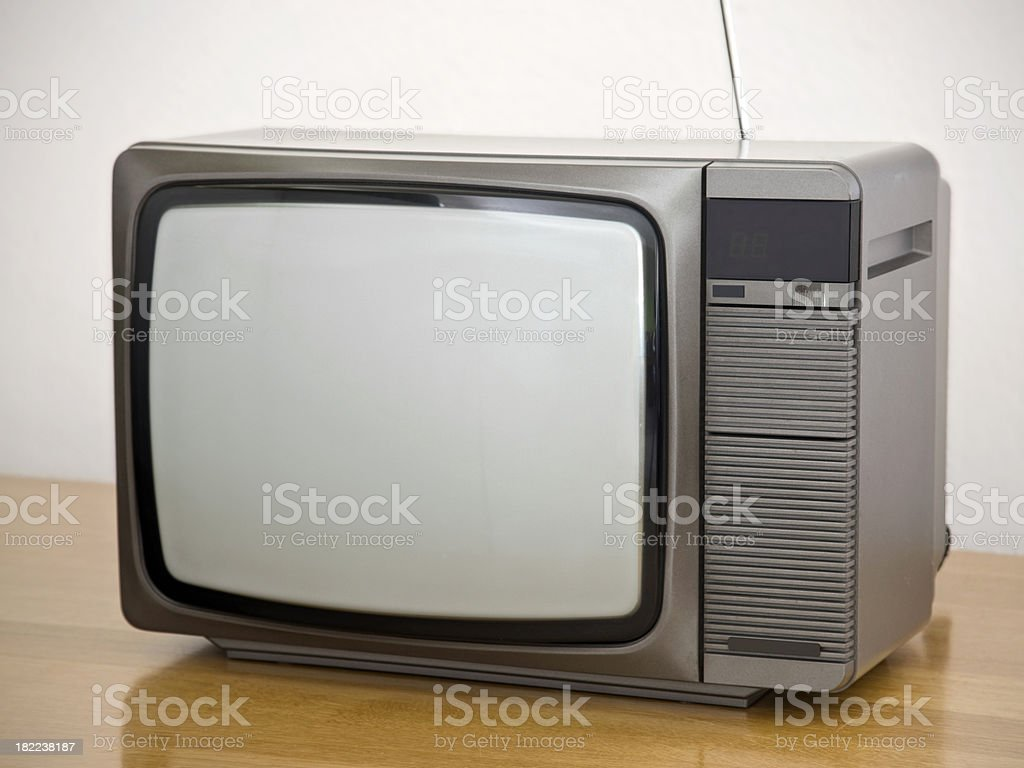 Small sized retro color TV on oak table (early 80's) royalty-free stock photo