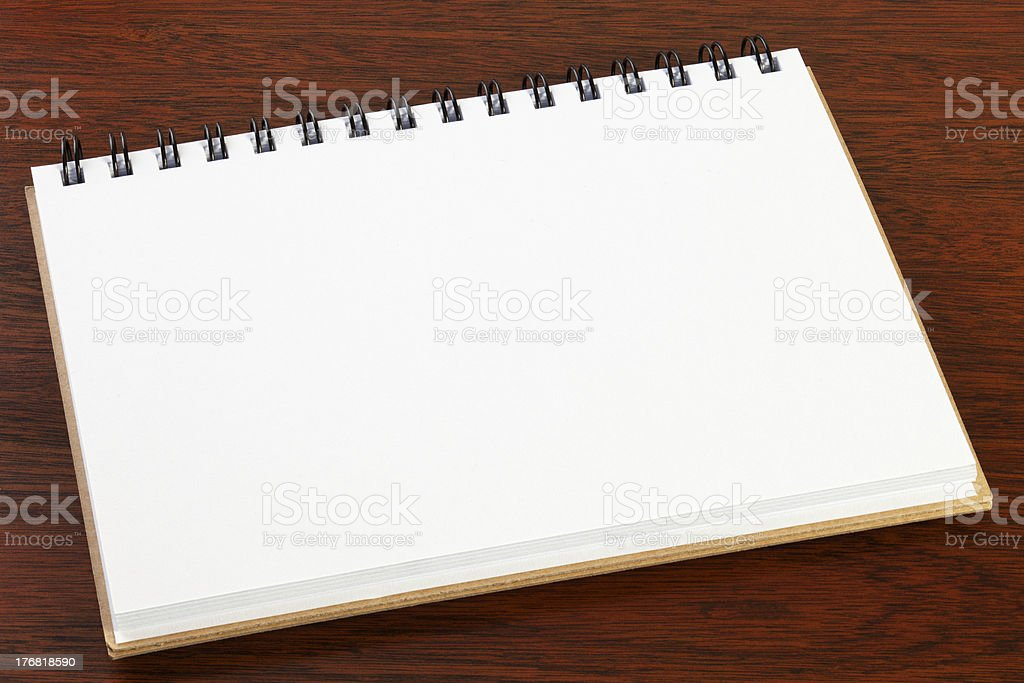 Small Sketch Pad on Dark Oak Background royalty-free stock photo