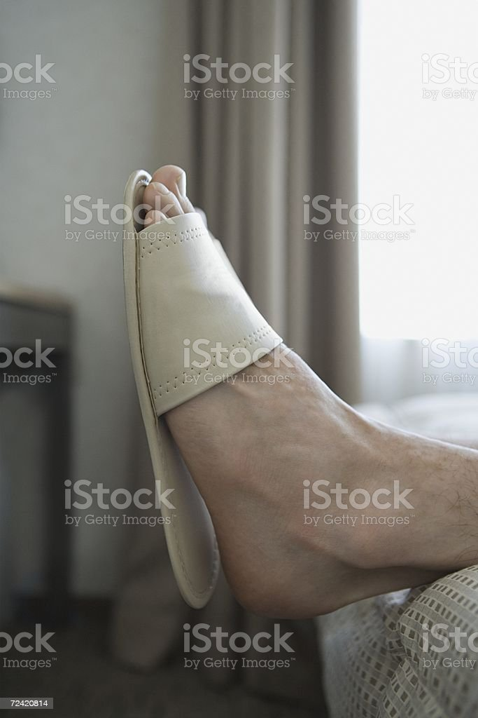 A small slipper on a foot royalty-free stock photo