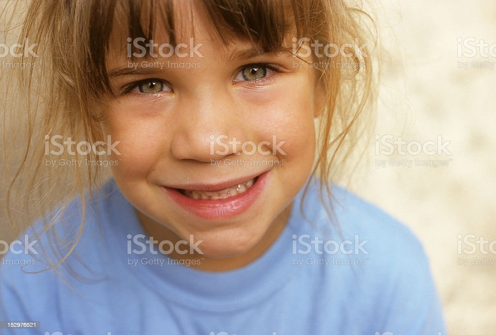 small smiling child wearing a blue shirt royalty-free stock photo