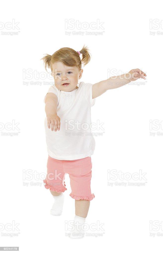 Small smiling girl make gymnastic exercise royalty-free stock photo